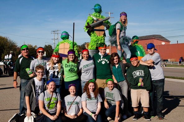 Teenage Mutant Ninja Turtle Float builders enjoy their victory.