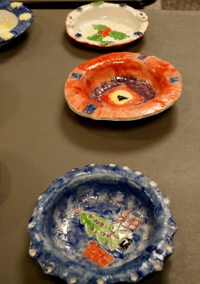 A small sampling of the hundreds of bowls created by our art students!