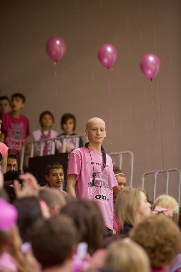 Cam McKinnon, JHS student who is fighting bone cancer and postponed his last chemo treatment on Friday to play in the PINK OUT Pep Band. An inspiring young man.